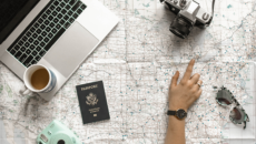 woman looking at map with passport