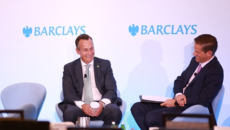 Greg Braca talking on stage at Barclays