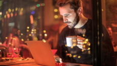man at computer at night