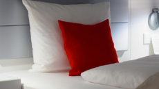 mattress with red and white pillow