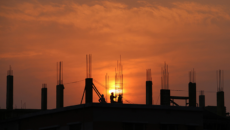 Construction workers in silhouette