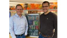 Shawn and Jason with the soda fridge