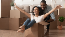 couple in process of moving, girl in a box