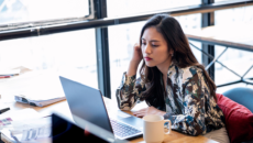 Woman looking concerned at a laptop
