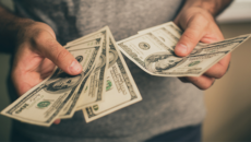 business owner holding cash