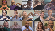 employees making hand hearts