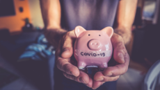 """Piggy bank that says """"COVID-19"""" on it"""