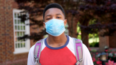 African American teenager wearing a face mask