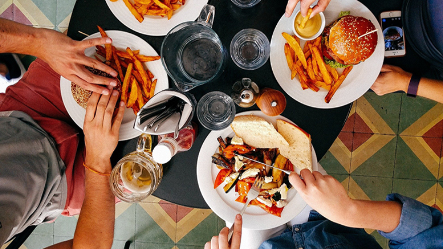 overhead view of food on a restaurant table