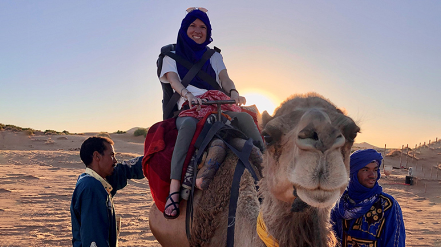 Caitlin Messick on a camel in Morocco