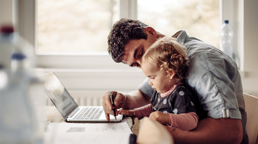 Young father working from home with child