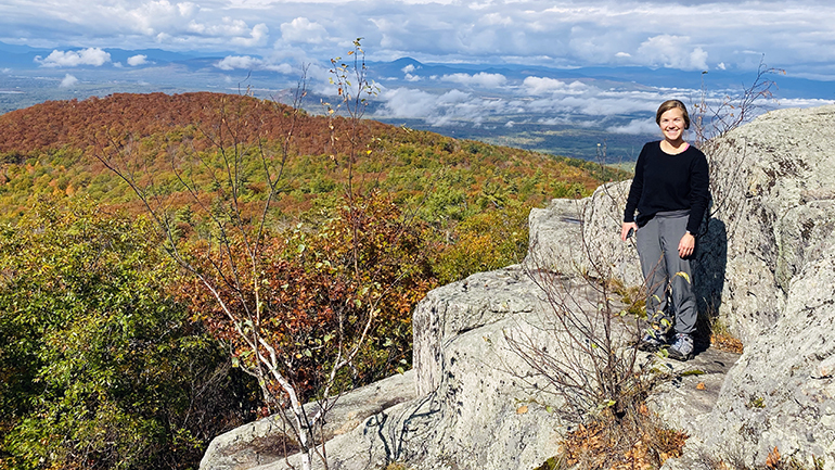 Jade Wronowski, training coach for MainHealth, hiking in Maine