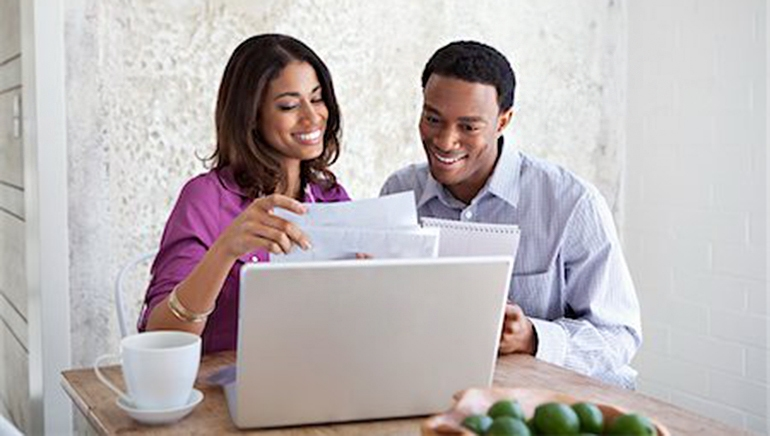 couple looking at computer