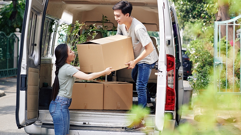 couple unloading a moving truck